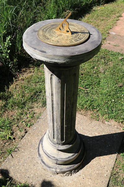 """13 JUN 2021 - Sundial at Bobbit's Hole Nature Reserve, in remembrance of those affected by the Coronavirus Pandemic 2020/21. 13 JUN 2021 - Photo Copyright © Maria Fowler 2021<br /> <br /> PRESS RELEASE<br /> Harwich Society installs COVID-19 memorial in Bobbit's Hole<br /> <br /> The Harwich Society has installed a memorial to the memory of everyone who passed during the COVID-19 pandemic and whose loved ones were not able to commemorate their passing in the manner in which they would have wished.<br /> <br /> The board of Trustees believed that there was a need for such a memorial and, as a result, a sun dial has been erected in the Society's Bobbit's Hole Nature Reserve bearing the inscription, 'However dark the clouds are the Sun is always shining above them '.<br /> <br /> Chairman of the Harwich Society, Colin Farnell, says, """"COVID-19 has had an impact on everyone who has lost someone close to them whether it was as a result of the disease or not. No one has been able to commemorate the end of a life in the manner that they would have wished and this memorial is for everyone who has found themselves in this position.""""<br /> <br /> The inscription was suggested by one of the Harwich Society's trustees who heard the late Dr. Perry use the words in an address given in Saint Nicholas Church in 2000.<br /> <br /> """"We wanted a memorial that would reflect the need and would be appropriate for everyone,"""" continued Colin Farnell. """"A sun dial is timeless and the inscription offers hope at a difficult time. We hope it will provide a point of comfort.""""<br /> <br /> A bench is to be installed adjacent to the memorial.<br /> <br /> An official unveiling is to be arranged once COVID-19 restrictions are no longer in place.<br /> <br /> For further information please contact<br /> <br /> Colin Farnell on 01255 553610<br /> Garry Calver on 01255 551940"""