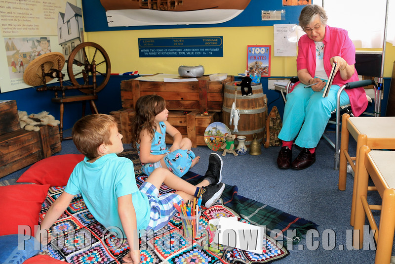 Dylan Street age 6, Darcie Street age 4, from Romford, with Storyteller Mary Lake.