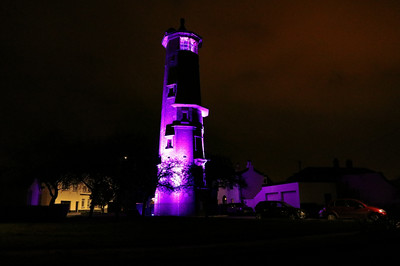 """20 MAR 2021 Harwich High Lighthouse, Census 2021 'Light Up Purple' – Photo Copyright © Maria Fowler 2021  PRESS RELEASE: Harwich High Lighthouse goes purple in celebration of Census 2021  Harwich High Lighthouse joined more than a hundred buildings and landmarks across England and Wales by lighting up purple to celebrate the upcoming census and its importance to communities.   The event was organised by The Office for National Statistics (ONS) to raise awareness of the census, a survey that happens every ten years and gives a picture of all the people and households in England and Wales.   Other iconic landmarks included the Wales Millennium Centre in Cardiff, BT Tower in London and Blackpool Tower which took part in the celebration, seeing them light up in the Census 2021 brand colour from Friday March 19 through to March 21.  The census helps inform the provision of public services throughout the UK, such as determining the appropriate number of school places and hospital beds that are needed to properly serve their communities.   Pete Benton, ONS Director of Census Operations, commented:   """"The census is such an important undertaking that helps inform the vital services we all rely on every single day within our communities.   """"We wanted to shine a (purple!) light on the buildings and landmarks that matter most to their local areas, highlighting the importance of the census in helping shape the communities we live in.   """"We're thrilled with all the support we have received so far and would like to thank Harwich for their participation. Now is the time for everyone to complete their census and be part of history""""   Every household in England and Wales should have received their census letters with unique access codes enabling them to fill in their census online.  Paper forms are available for those who need it, plus a range of other support.   In the coming days, the census field operation will begin contacting households who have not completed their census. They """