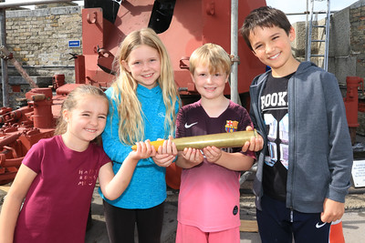 12 SEP 2020 – Pictured L-R:  Marissa Groom (age 4), Gracie Phillips (age 9), Ronnie Phillips (age 6) and Luca Groom (age 8) with a shell from Bofors anti-aircraft gun - Harwich Redoubt Fort – Heritage Open Days – Photo Copyright © Maria Fowler 2020
