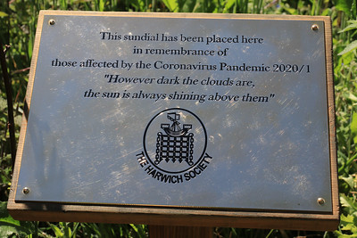 """13 JUN 2021 - Sundial at Bobbit's Hole Nature Reserve, in remembrance of those affected by the Coronavirus Pandemic 2020/21. 13 JUN 2021 - Photo Copyright © Maria Fowler 2021  PRESS RELEASE  Harwich Society installs COVID-19 memorial in Bobbit's Hole  The Harwich Society has installed a memorial to the memory of everyone who passed during the COVID-19 pandemic and whose loved ones were not able to commemorate their passing in the manner in which they would have wished.  The board of Trustees believed that there was a need for such a memorial and, as a result, a sun dial has been erected in the Society's Bobbit's Hole Nature Reserve bearing the inscription, 'However dark the clouds are the Sun is always shining above them '.  Chairman of the Harwich Society, Colin Farnell, says, """"COVID-19 has had an impact on everyone who has lost someone close to them whether it was as a result of the disease or not. No one has been able to commemorate the end of a life in the manner that they would have wished and this memorial is for everyone who has found themselves in this position.""""  The inscription was suggested by one of the Harwich Society's trustees who heard the late Dr. Perry use the words in an address given in Saint Nicholas Church in 2000.  """"We wanted a memorial that would reflect the need and would be appropriate for everyone,"""" continued Colin Farnell. """"A sun dial is timeless and the inscription offers hope at a difficult time. We hope it will provide a point of comfort.""""  A bench is to be installed adjacent to the memorial.  An official unveiling is to be arranged once COVID-19 restrictions are no longer in place.  For further information please contact  Colin Farnell on 01255 553610 Garry Calver on 01255 551940"""