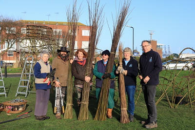 01 FEB 2020 Pictured L-R Cheryl Thompson (Harwich Society Gardening Group), Adam Lawes (Willow Phoenix), Emma Lucas (Willow Phoenix) Terry Rogers (Harwich Society Gardening Group), Aileen and Colin Farnell (Harwich Society Gardening Group) - Mayflower willow sculpture -  Photo Copyright © Maria Fowler 2020