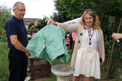 01 AUG 2021 – PICTURED: Colin Farnell (Chairman, The Harwich Society) and Liana Bridges (BBC Essex Quest) unveiling of the Harwich Society COVID-19 memorial sundial  - Bobbit's Hole Open Day & Charity Stroll – Photo Copyright © Maria Fowler 2021