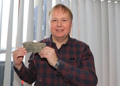 26 OCT 2019 – PICTURED: Richard Oxborrow (Trustee, Harwich Society) with piece of pottery discovered at a 14th century property in Kings Head Street, Harwich, believed to be the beginnings of Harwich in the 12th  century. - Harwich Society History Fair – 1912 Centre – Photo Copyright © Maria Fowler 2019