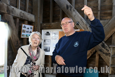 Josephine McElroy from Dovercourt with Harwich Society volunteer John Wade  inside the Treadwheel Crane