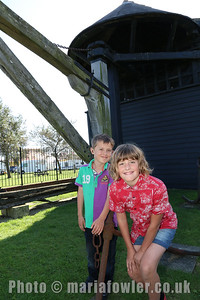 Liam and Rosie Mortimer (age 8 and 10, Two Village School) outside the Treadwheel Crane, Harwich.