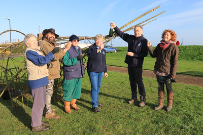 01 FEB 2020 - Pictured L-R Cheryl Thompson (Harwich Society Gardening Group), Adam Lawes (Willow Phoenix), Terry Rogers (Harwich Society Gardening Group), Aileen and Colin Farnell (Harwich Society Gardening Group) and Emma Lucas (Willow Phoenix) - Mayflower willow sculpture -  Photo Copyright © Maria Fowler 2020