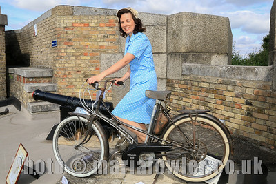 Gemma Quinn, (Dovercourt Theatre Group) in period costume with a restored antique 1952 Motobécane Mobylette AV3