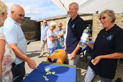 The Bottle Stall with Harwich Society volunteers  Barry Sharp, Pauline Sharp. (right)