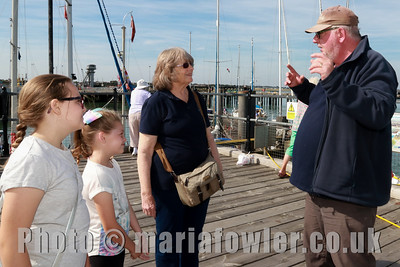 28 AUG 2017 Harwich Society Storytelling Day at the Visitor Centre, Ha'Penny Pier. Pictured: Maddie Hymers age 10, Mayflower Primary School and Megan Hymers, age 9, Mayflower Primary School with grandmother Anne Crotty and storyteller David Whitehead.