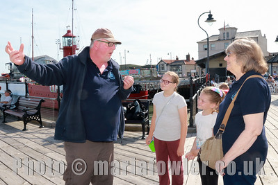 28 AUG 2017 Harwich Society Storytelling Day at the Visitor Centre, Ha'Penny Pier. Pictured: Storyteller David Whitehead with Maddie Hymers age 10, Mayflower Primary School and Megan Hymers, age 9, Mayflower Primary School with Grandmother Anne Crotty.