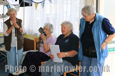 A singalong with local author June Bretherton, Sheila Normington (with Alfred the cat) Lesley Elliot and Marian Heath.