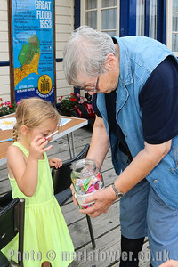 Danni Allard age 6 and Storyteller Marian Heath with the drawing competition sweetie jar!