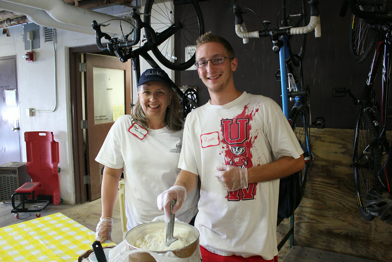 Center Financial Specialist, Carol Jenkins Espinoza helps with scooping up Badger Ice Cream!