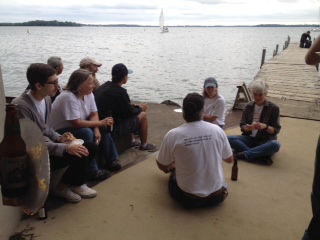 Staff, faculty, students, post docs, family members, volunteers enjoying pizza and rest on the CFL dock - after Open House