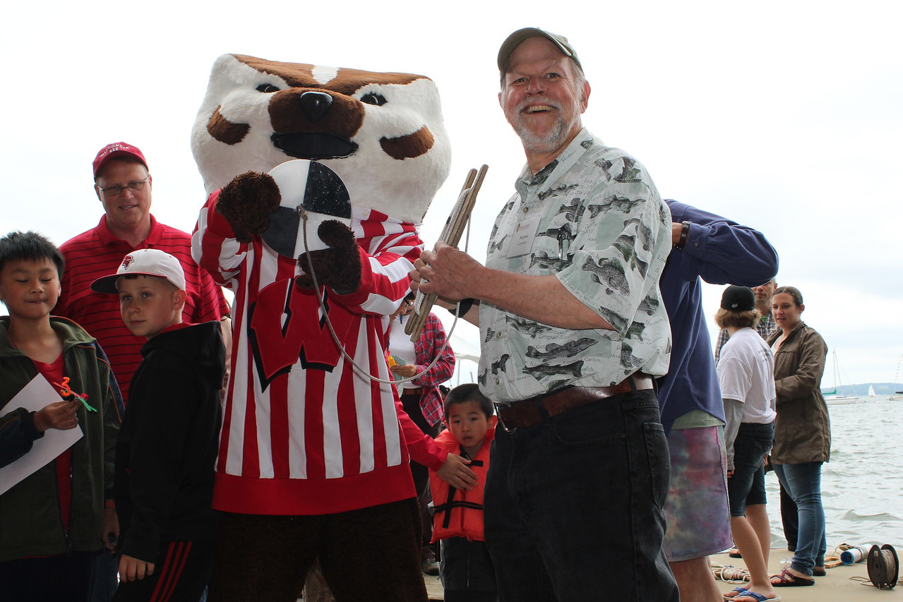 Bucky Badger and CFL Director Steve Carpenter with secchi disk