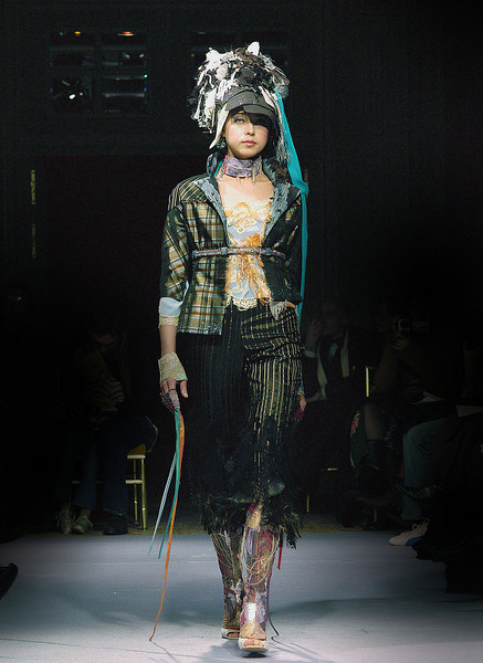 """A model walks the runway presenting  creation by Yassen Samouilov , Livia Stoianova, André de Sà Pessoa for the fashion show of On Aura Tout Vu Fall Spring Summer 2004 during the Haute Couture Fashion Week Paris. The """" white magic and black magic """"collection."""