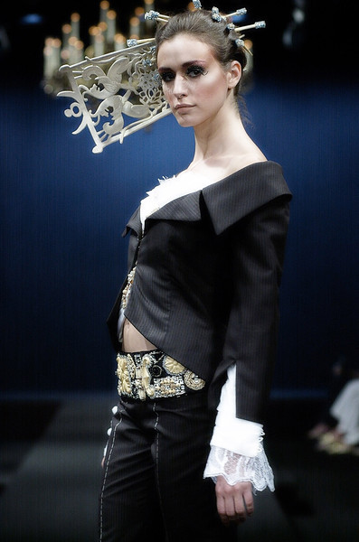 "A model walks the runway presenting  creation by Yassen Samouilov , Livia Stoianova, André de Sà Pessoa for the fashion show of On Aura Tout Vu  Fall Winter 2005-2006 during the Haute Couture Fashion Week Paris. The ""Enchanted Forest""collection."