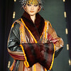 """A model walks the runway presenting a creation by Yassen Samouilov & Livia Stoianova & André de Sà Pessoa for the fashion show of On Aura Tout Vu Fall Winter 2002-2003 during Haute Couture Fashion Week Paris.""""Glob Troter"""" Collection."""