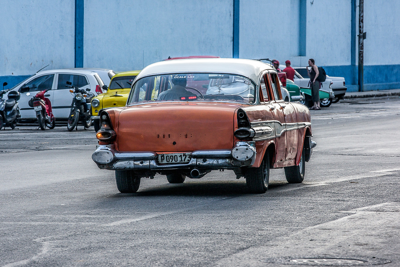 Orange American Car in Havana Street Scene