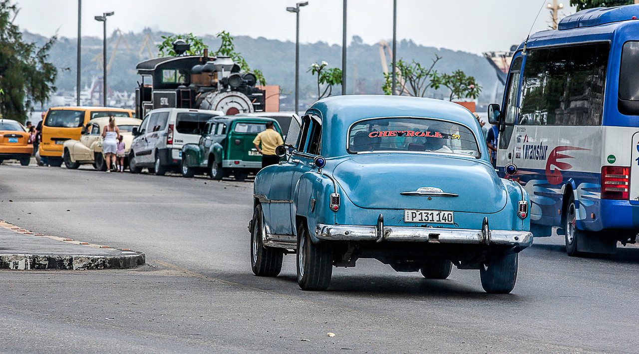 Old American Car and Old American Steam Train in Havana