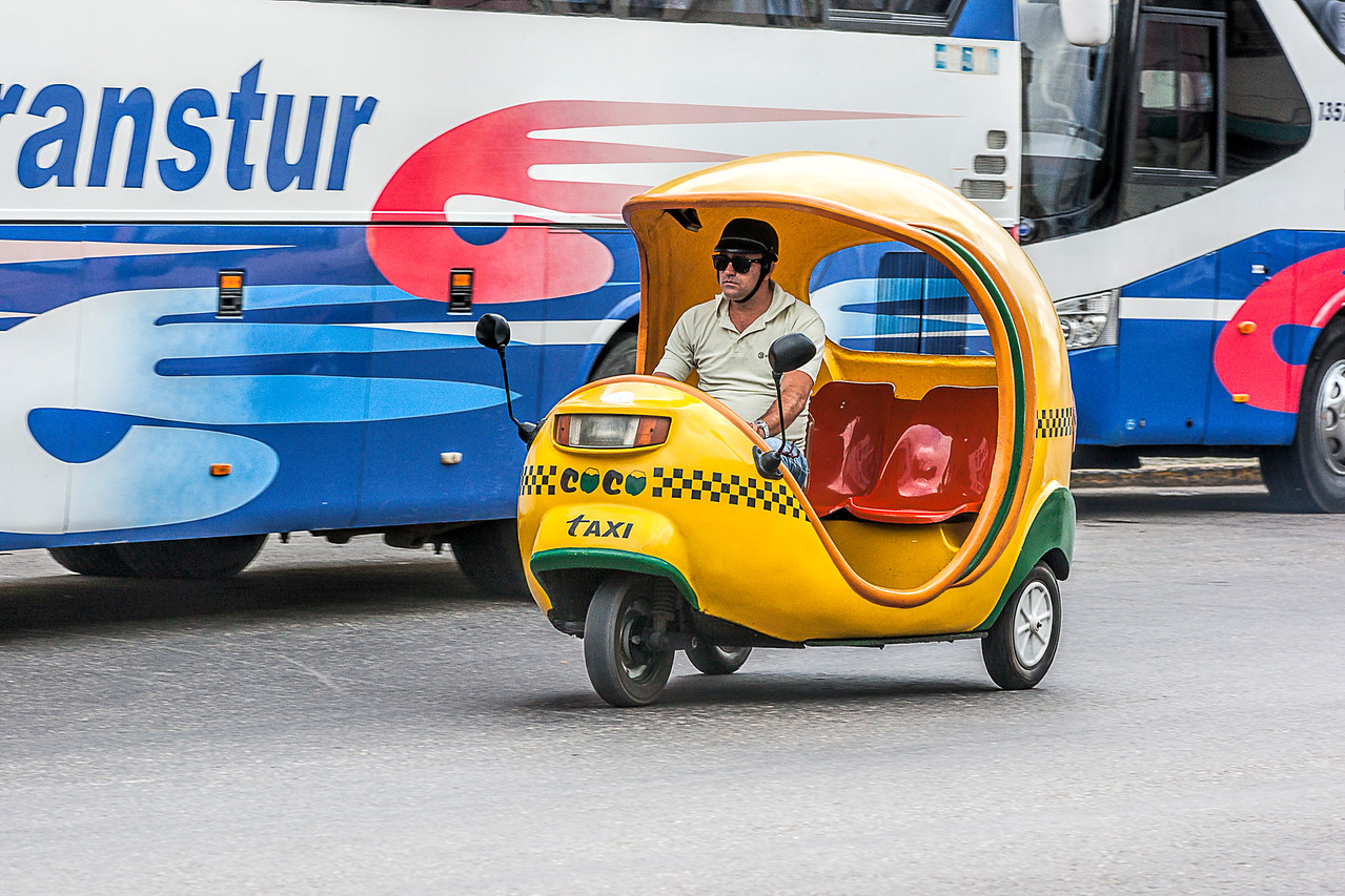 Yellow Three Wheeled Taxi in Havana
