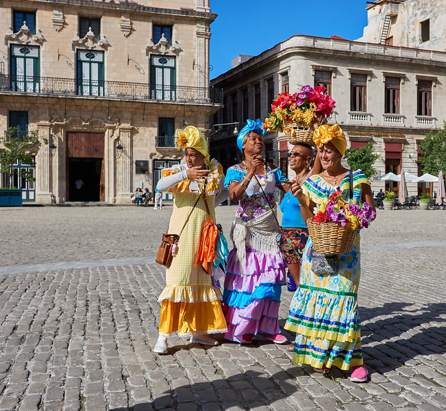 Women in traditional dresses in Havana