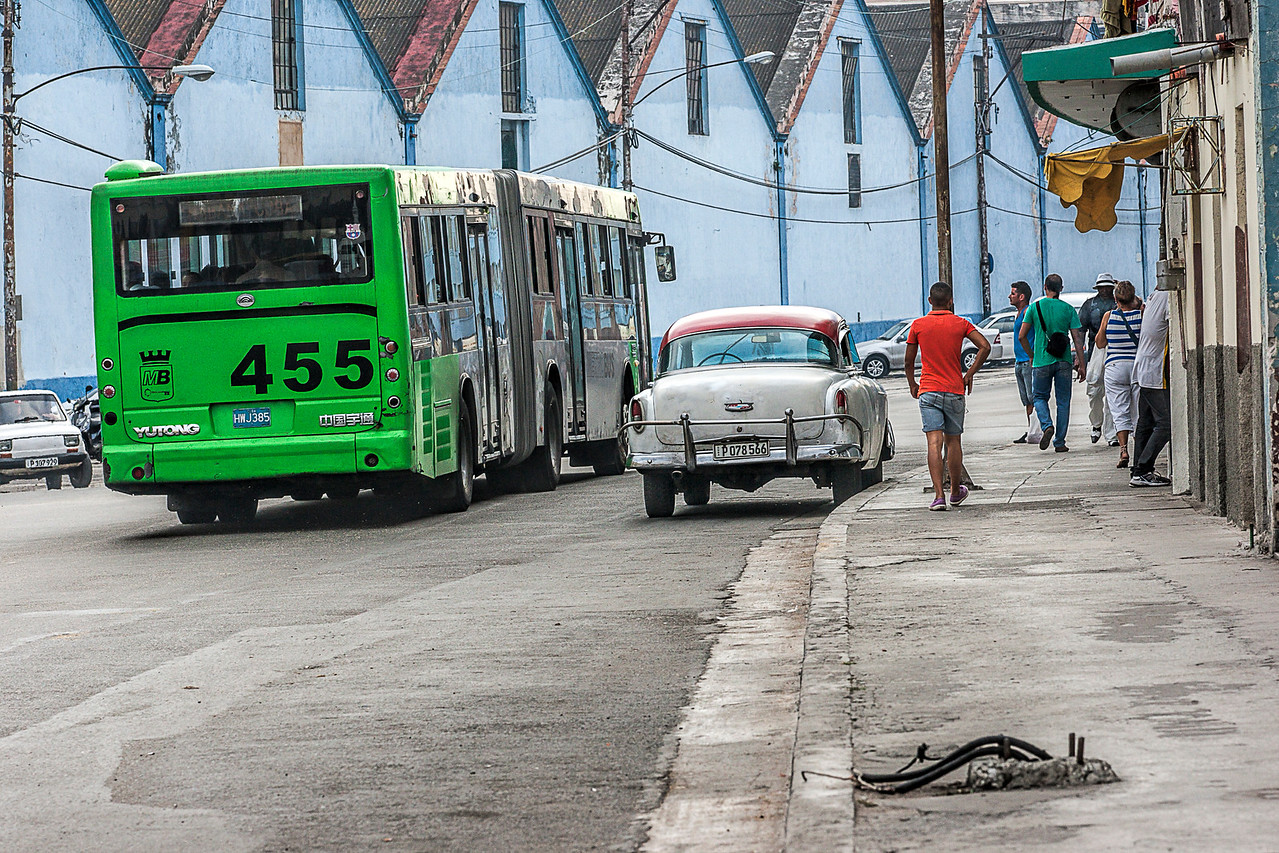 Green bus in Street Scene in Havana
