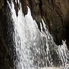 Fifty-Foot Falls from inside a travertine canopy.