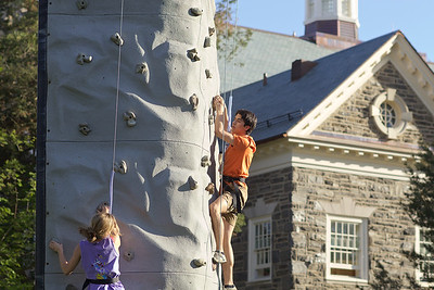 Students on the climbing wall at Haverfest. Photo by Caleb Eckert.