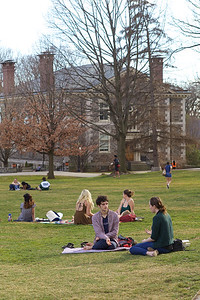 Ethan Adelman-Sil '17 (center) and Hannah Zeigler '17 (right) on Founders Green. Photo by Caleb Eckert.