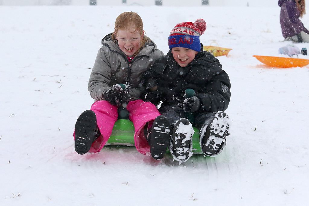 . The hill next to Cherry Hill Ice Cream in Lunenburg is a great place to have fun on a snow day. Getting ready to head down the hill on a tandem sled is Rebecca Noon, 10,and Finn McNabb, 11, both of Townsend. SENTINEL & ENTERPRISE/JOHN LOVE