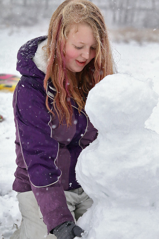 . The hill next to Cherry Hill Ice Cream in Lunenburg is a great place to have fun on a snow day. During Wednesday\'s storm Lilly Noon, 13, of Townsend got make a snowman. SENTINEL & ENTERPRISE/JOHN LOVE