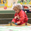 They Ayer Library's childrens room was full of kids having fun just before story time started with Childrens Librarian Amy Leonard on Thursday morning. Playing with some toy trains at the library as he waits for story time is Joey Marotto, 4, of Chelmsford. SUN/JOHN LOVE