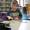 They Ayer Library's childrens room was full of kids having fun just before story time started with Childrens Librarian Amy Leonard on Thursday morning. Play the Pokemon card game at the library is Izaac Hiles, 8 pictured, of Lunenburg against Henry Butler, 6, of Hudson.  SUN/JOHN LOVE