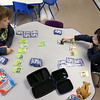 They Ayer Library's childrens room was full of kids having fun just before story time started with Childrens Librarian Amy Leonard on Thursday morning. Play the Pokemon card game at the library is Izaac Hiles, 8 on left, of Lunenburg and Henry Butler, 6, of Hudson.  SUN/JOHN LOVE
