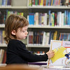 They Ayer Library's childrens room was full of kids having fun just before story time started with Childrens Librarian Amy Leonard on Thursday morning. Reading about Disney prinesses at the library as she waits for story time is Simone Butler, 4, of Hudson. SUN/JOHN LOVE