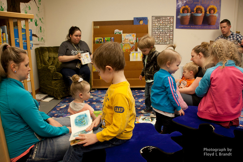 Havre Daily News/Floyd Brandt<br /> <br /> Havre-Hill County Libaray Books and Babies met Wednesday to listen to a story about a Nome. Then do the activity project of putting together a Nome mushroom house.