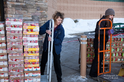 IGA Assistant Manager Brenda Friede muscles out a cart full of canned soup as Jessica Cox IGA Cashier loads food into a truck that was donated from IGA Tuesday, for the Havre Food Bank. Gary and Leo's have been donating food to the food bank and community out reach programs for the past 17 years.
