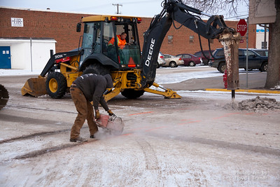 Charlie Hopkins cuts the asphalt as Vince Fox breaks up the asphalt with a jack hammer on Second Street Wednesday January 25, 2017 in preperation to fix a six indh fire water main that broke. Patrick Construction Foreman Dan Stygles said that it was going to take up to three days to repair, that Second Street at Second Avenue would be closed until repairs were finished.