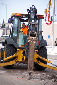 Vince Fox breaks the asphalt with a jack hammer on Second Street Wednesday January 25, 2017 in preperation to fix a six indh fire water main that broke. Patrick Construction Foreman Dan Stygles said that it was going to take up to three days to repair, that Second Street at Second Avenue would be closed until repairs were finished.