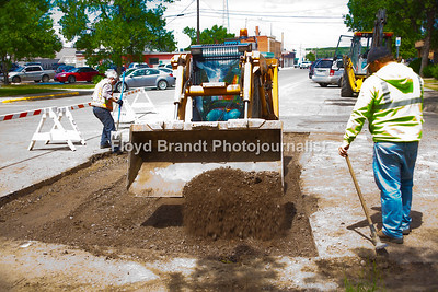 Havre Daily News/Floyd Brandt  Havre city workers (left) Dave Dorr, Jack Teske and Jordan Schend prepares the roadway at 4th Avenue and 4th Street for repaving Monday. Crews had to dig up the road in April when the water main broke, the second time at this intersection. The first break was in March when a valve had to be replaced, the road shouls be fixed by weeks end.