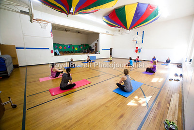 Havre Daily News/Floyd Brandt  Community Education Pilates Instructor Ronda Holland begins the class with streches to warm up at Lincoln - McKinley School Monday. The Class can improve flexibility, strength and coordination, it is held on Mondays and Wednesdays. For more information www.blueponyk12.com click on Community Education.