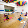 """Havre Daily News/Floyd Brandt<br /> <br /> Community Education Pilates Instructor Ronda Holland begins the class with streches to warm up at Lincoln - McKinley School Monday. The Class can improve flexibility, strength and coordination, it is held on Mondays and Wednesdays. For more information  <a href=""""http://www.blueponyk12.com"""">http://www.blueponyk12.com</a> click on Community Education."""