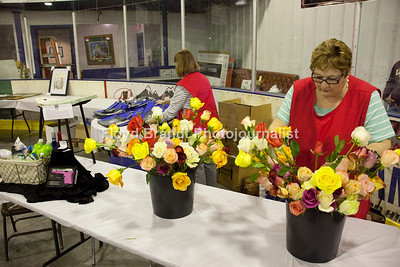 Havre Daily News/Floyd Brandt  Walleye banque at Havre Ice Dome Saturday where Lil Foussand and Snannon Buettner sell roses for the Walleye Assocation to raise money. With the purchase of each rose a chance to win prizes.