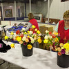 Havre Daily News/Floyd Brandt<br /> <br /> Walleye banque at Havre Ice Dome Saturday where Lil Foussand and Snannon Buettner sell roses for the Walleye Assocation to raise money. With the purchase of each rose a chance to win prizes.