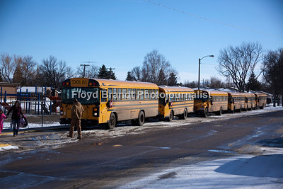School buses line up for precious cargo at one of Havre schools Monday. Giving students a safe ride home is top on the list for the divers of these giant limousines. Not as plush as a limousine they offer protection and warmth on a cold day to and from school.