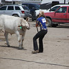 Havre Daily News / Floyd Brandt<br /> <br /> Jaye Anderson 4H / FFA Senior Beef Showing Blain County Fair Saturday, with Buddy who just did not want co-operate.
