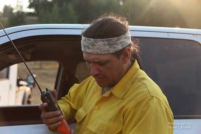 Havre Daily News/Floyd Brandt  Theron Oats is the Fire Management Officer for the tribe at Rocky Boy keeping in contact with personal on the fire line directing people to different position and jobs Tuesday. He talked about tactical air support flying in the sky reporting the location of the fire, the crews on the ground and aircraft that is used to drop water and retardant which are being dropped today.