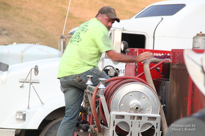 Havre Daily News/Floyd Brandt  Joe Ostrom is driving a water truck refilling the tankers that are used to fight the fire on the front lines Tuesday. Sleeping in the cab of the truck he drives, he has been been at the Left Fork fire since Sunday keeping the tankers filled.